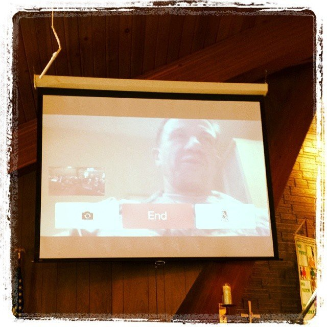 Pastor Jim Buckman, a chaplain with the US Air Forces appears on screen with a live call in during Sunday Morning Worship.